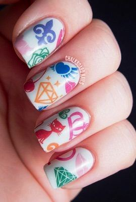 Let these trendy and colorful nail tattoos make you the diva! Diamonds